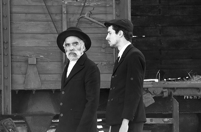 Hermann Sámuel (Iván Angelus) and his son (Marcell Nagy) arrive via train to a small village in Hungary full of secrets. Photo credit: Lenke Szilagyi / Menemsha Films