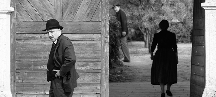 Town clerk István Szentes (Péter Rudolf) worries about his town's unwelcome visitors, while Mr. and Mrs. Kustár (József Szarvas, Ági Szirtes) linger in the background. Photo credit: Lenke Szilagyi / Menemsha Films
