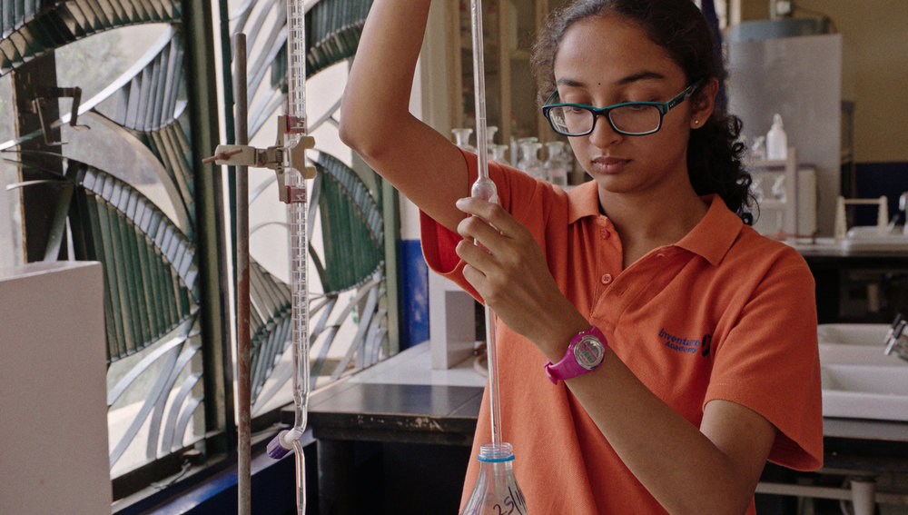 Sahithi Pingali in Inventure Academy lab; Bangalore, India. After the lake behind Sahithi's school caught fire twice, she invented a water-testing system, then crowd-sourced it online. Photo credit: IQ190 Productions LLC.