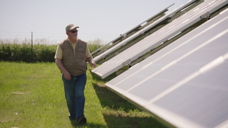 Warren McKenna visits the solar farm at Farmers Electric Cooperative in Kalona, Iowa. Credit - Nick Midwig.